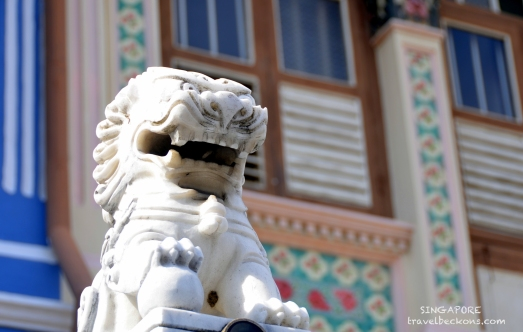 A lion statue along the conserved residences in the East
